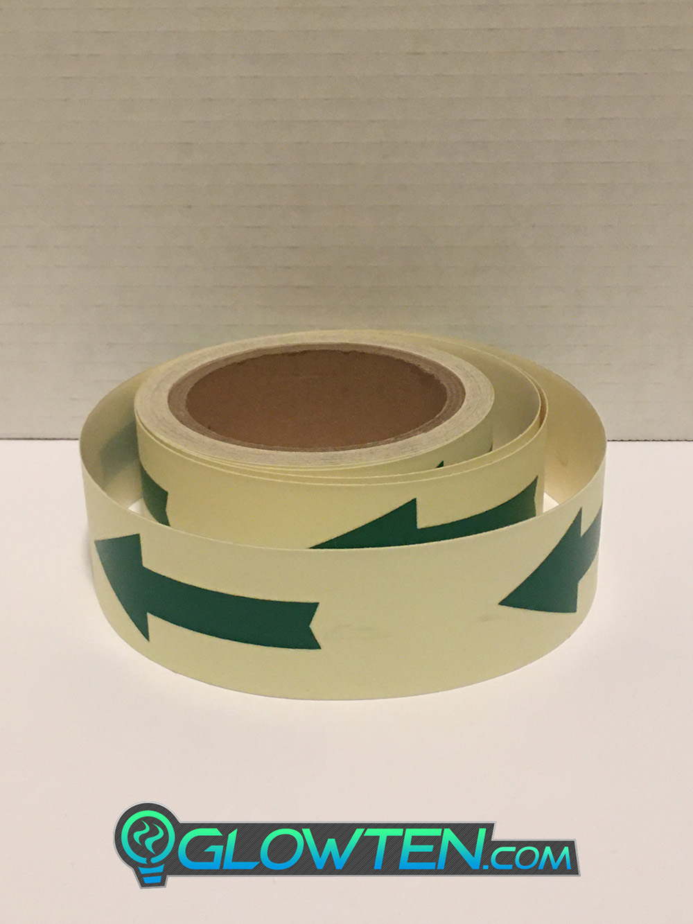 GLOWTEN.com - ARROW POINT TAPE Glow in the Dark Green Single Direction Sign All Purpose Tape Roll Lite Green Absorbs photons from any light source and then this stored energy is released in the dark, resulting in the glowing effect 1 One